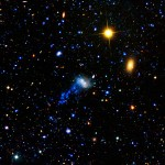 NASA's Galaxy Evolution Explorer found a tail behind a galaxy called IC 3418.