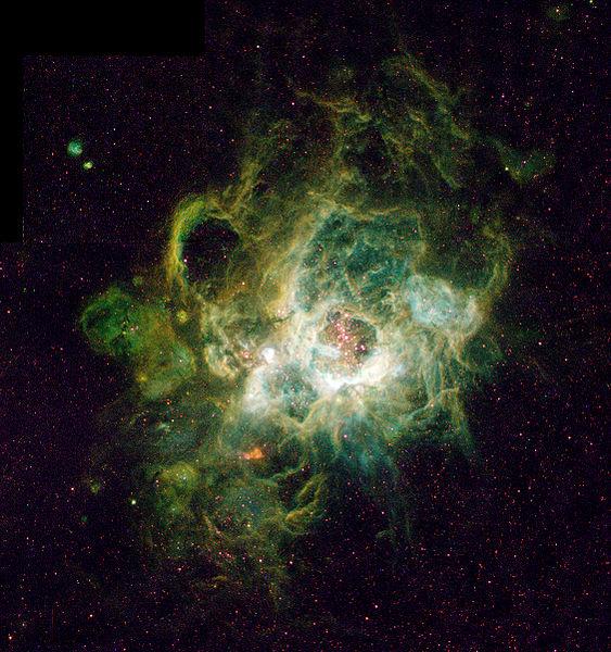 NGC 604, nebulosa e berçário de estrelas em M 33, uma das maiores nebulosas desse tipo conhecidas. (Crédito